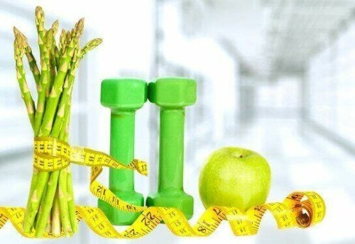 målebånd om håndvægte og grønt