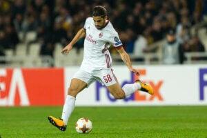 Un joueur du A.C. Milan, en pleine action lors d'un match.