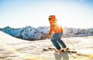 Un skieur sur une piste de ski à la montagne.