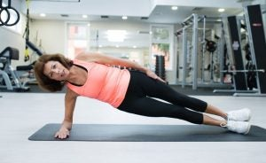 Woman doing side plank at the gym
