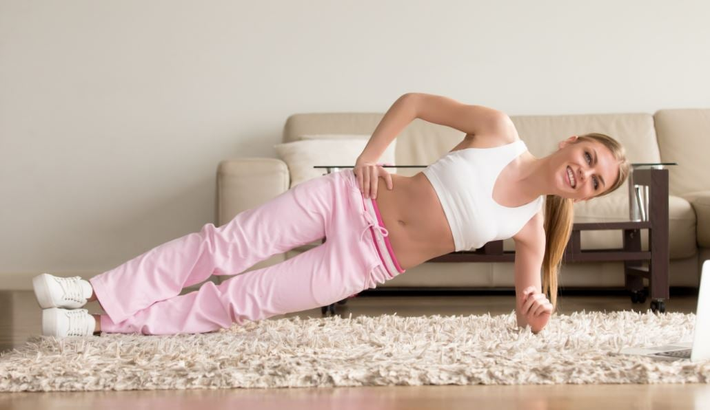 Woman doing side plank position
