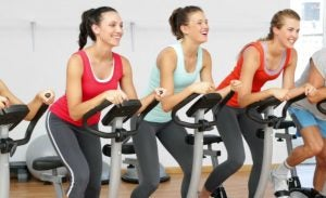 Women doing spinning and indoor cycling.