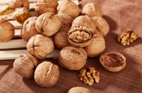 whole and cracked walnuts