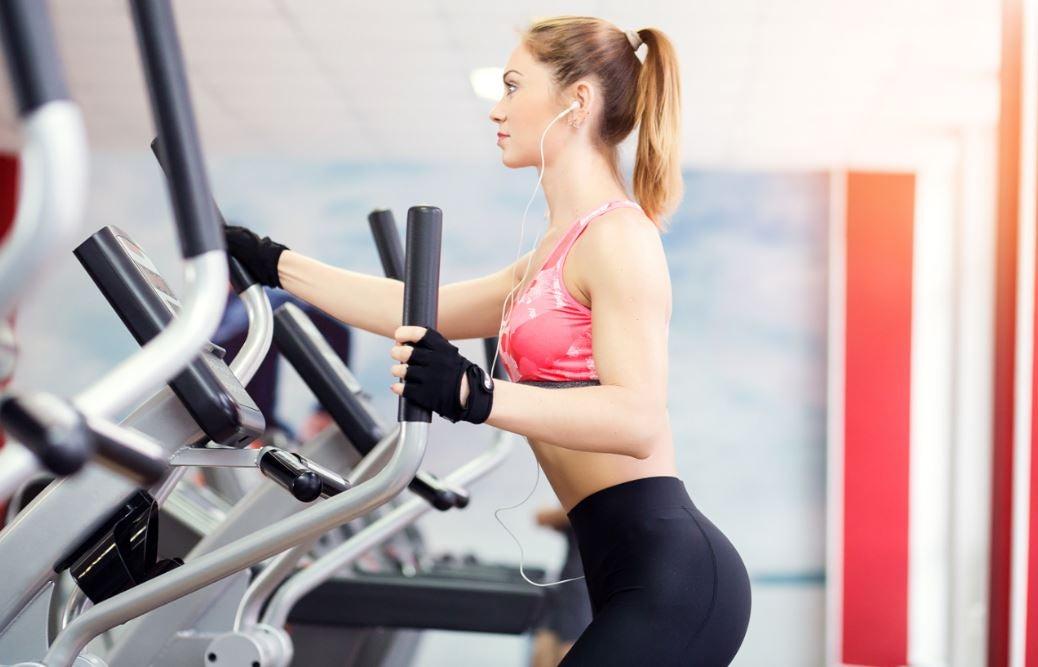 Woman using elliptical