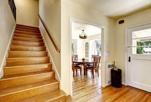 stairwell and dining area with wood floors