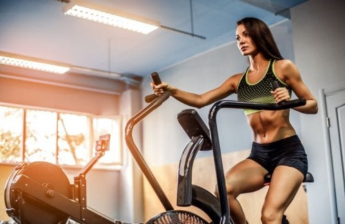 woman at gym seated elliptical trainers