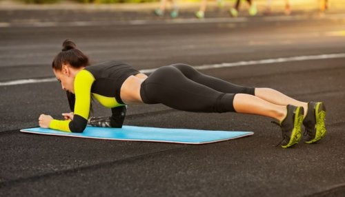 woman doing plank outside
