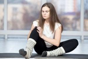 Woman experiencing soreness