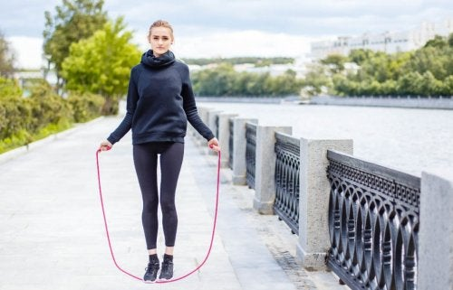 woman jumping rope by river