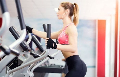woman at gym with elliptical machines