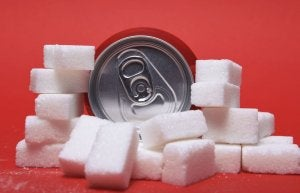 Sugar myths: soda can with a lot of sugar.