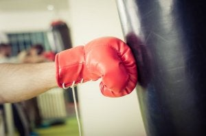Boxing glove hitting punching bag