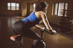 Woman on a stationary bicycle equipment.