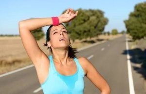 Lactic acid effect. Woman after running.
