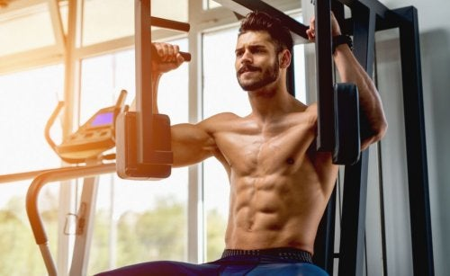 fit man on chest press machine at gym
