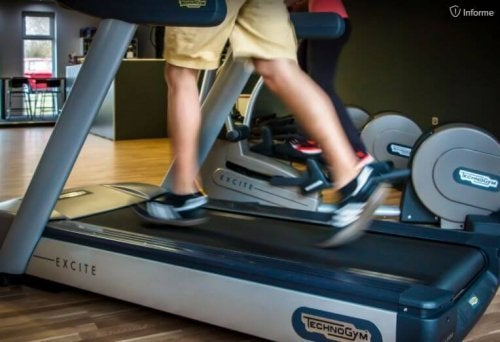 man's legs on a treadmill running outdoors or at the gym