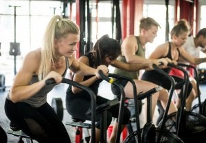 Woman using static bike in a spinning class