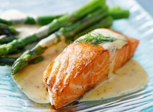Salmon with wild asparagus for fish dinner.