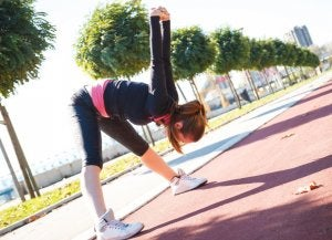 Woman stretching outdoors.