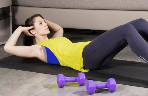 woman doing crunches in living room