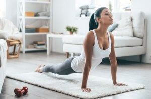 Woman doing Pilates at home