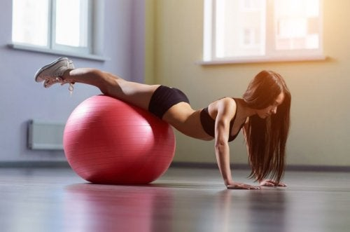 woman on exercise ball doing push-ups