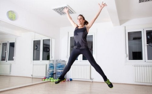 woman in mid jump at a studio