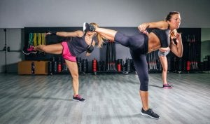 Women doing body combat at the gym.
