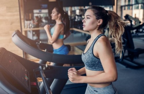 women running on treadmills gym