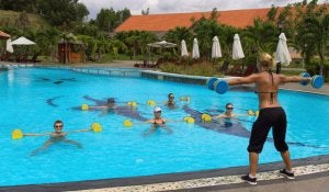 Group of people doing water aerobics.