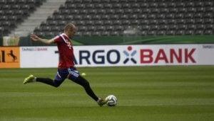 Arjen Robben kicking a ball.