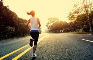 Girl running to the sunset.