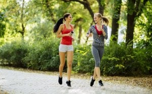 Two women running together.