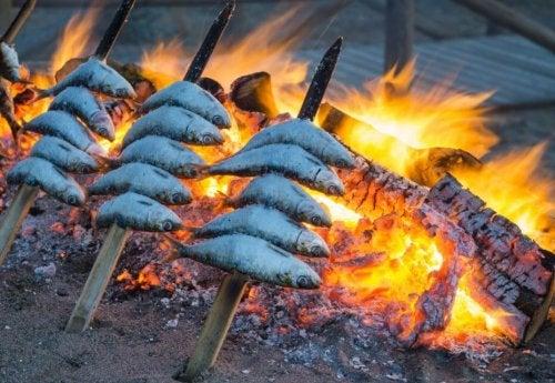 skewered sardines over embers Spain's typical healthy food