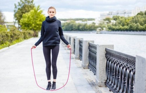 woman outside cloudy jump roping