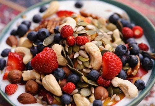healthy breakfast bowl with nuts, dried fruit and yogurt