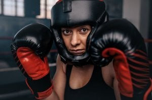 Woman using boxing gloves.