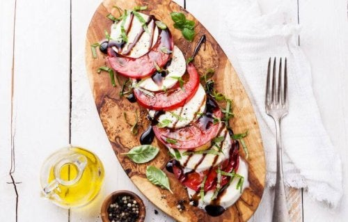 Wooden board with Caprese salad