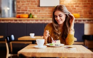 Woman eating a dessert in a coffee shop.