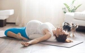 Pregnant woman doing great pilates exercises