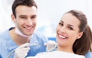 Woman in his dentist avoiding Halitosis