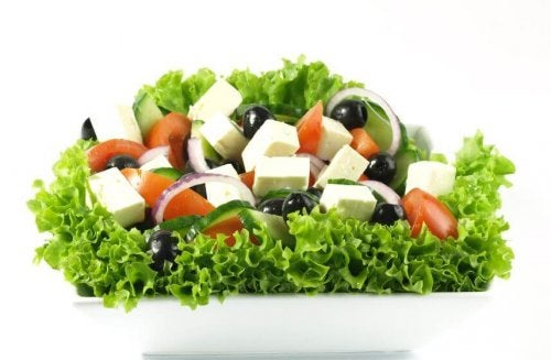 Salad with cheese, olives, tomatoes, lettuce