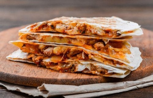 Quesadillas are wheat tortillas stuffed with cheese or other ingredients.
