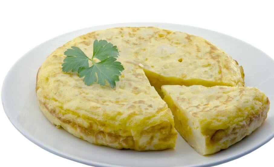 Freshly cooked microwave potato omelette with one slice out of it