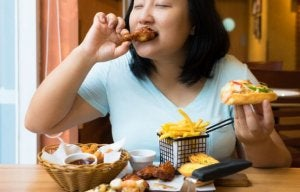 Woman not dieting and eating unhealthy food