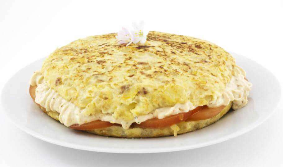 Potato omelette stuffed with cheese and tomato