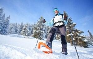 Woman practising snowshoeing.