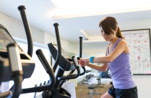 Woman on elliptical at gym