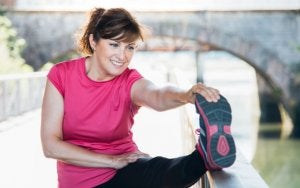 Psychological benefits of exercising, woman stretching.
