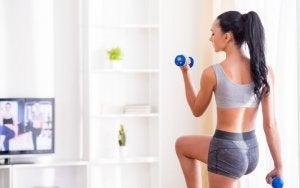 Fitness motivation: woman training at home.